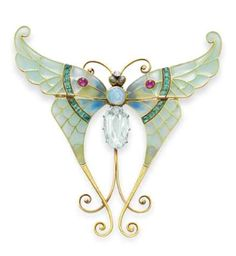 Art Nouveau Butterfly brooch made by Boucheron in November 1900 in Paris. In the shape of a butterfly, it was originally designed as a hair comb. The piece displays an extraordinary plique-à-jour  enamel work and it is set in calibre cut emeralds, cabochon rubies, opal and turquoise. Liz Taylor Collection