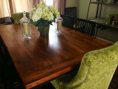 Barnwood table with upholstered chairs.