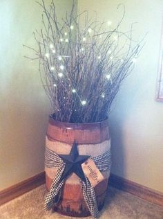 This is an old nail drum from coal mines. I decorated with twigs, lights, homespun fabric, piece of burlap , star