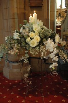 Large winter pedestal with candles, roses, orchids and dried materials