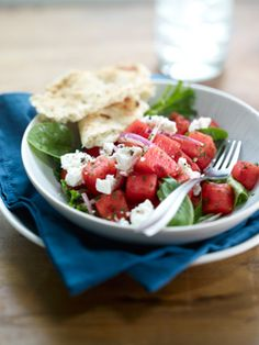 Mediterranean Watermelon Salad    Ingredients    6 cups torn mixed salad greens  3 cups cubed seeded watermelon  1/2 cup sliced onion  1 tablespoon extra virgin olive oil  1/3 cup crumbled feta cheese  1 dash cracked black pepper    Instructions    In large bowl, mix all ingredients except oil and pepper. Just before serving, toss salad mixture with oil. Garnish with pepper.    Servings    Makes 6 servings.