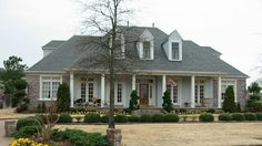1 story 3 bedroom 3 bath southern country farmhouse style house plan with charming appeal including two living areas fireplace in great roo