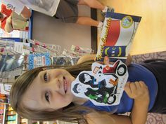 Sam and Sofia help pick a new postcard to send through Postcrossing.  #LittlePassports