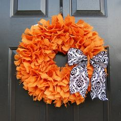 "orange, simple, loads of texture A shabby chic answer to the Halloween wreath! Each piece of burlap is hand cut and tied to a sturdy 4-ring box wire wreath. A 4"" black and white damask ribbon is added to give it the special touch. This wreath would be beautiful hanging on your front door, in a window, on a decorative wall hook, or inside a open back frame.   The wreath frame measures 14 inches but overall wreath width is over 18 inches."