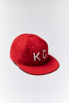 Cut to the pattern of a 1950's baseball cap. This fitted is sized traditionally and typically runs true to a normal hat size.  Authentic felt lettering Chambray lining underbill Cotton sweatband Single white eyelit detail 100% wool Dry clean or hand wash Style #H1005-RED