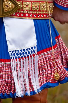 Masculine Sami splendor: The kirtles (tunics) from Kautokeino are traditionally blue with hundreds of meters of ribbons stitched on to red cloth at the hem. (links to gorgeous article)