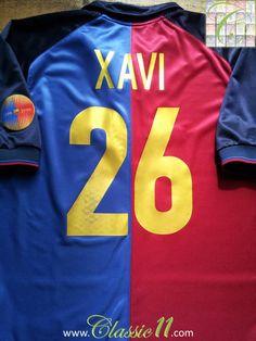 Relive Xavi's 1999/2000 season with this vintage Nike Barcelona home football shirt.