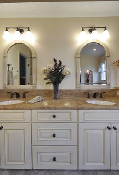 Beautiful Bathrooms in VA and MD The gracefully arched mirrors are topped with lighting by Mirabelle in oil rubbed bronze. Cabinetry is topped with Madura Gold granite. Granite Bathroom, Bronze Bathroom, White Bathroom, Bathroom Cabinets, Bathroom Vanities, Bathroom Mirror Lights, Bathroom Light Fixtures, Bathroom Vanity Lighting, Vanity Mirrors