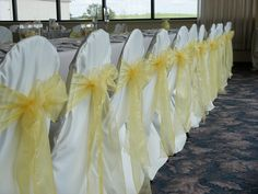 White Chair Covers w/ Yellow Organza Bows
