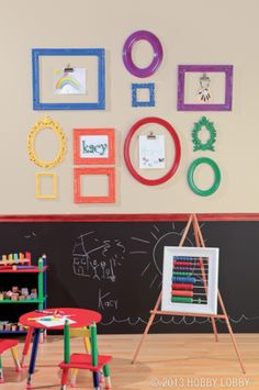 Use multi-colored frames to brighten up the play room