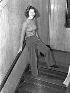 Teacher, Helen Hulick a witness to a burglary, was given a five-day sentence and sent to jail for contempt for wearing pants to give her courtroom testimony. Los Angeles. 1938.