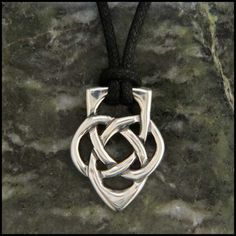 """This knot pendant or key ring in sterling silver was designed as a symbol of """"fatherhood"""" featuring three symbols: the eternity knot, the heart and the acorn shape. The eternity knot in the center is framed above and below by masculine angular arcs. The shape suggests an abstract acorn, a traditional symbol of strength and potential, as well as a heart for a father's unending love. Perfect Celtic Irish gift for a Father or Dad."""