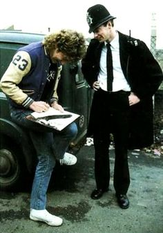Robert Plant of Led Zeppelin autographing for a constable