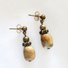 These pretty earrings feature a beautiful agate gemstone in shades of orange, rust, yellow, gray and amber with antique bronze spacers and small beads. Etsy Earrings, Drop Earrings, Agate Gemstone, Amber, Bronze, Turquoise, Gemstones, Beads, Antiques