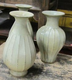 Contemporary Chinese ribbed ceramic pale green vases. www.balsamoantiques.com Chinese Ribs, Green Vase, Vases, Ceramics, Contemporary, Design, Home Decor, Ceramica, Pottery
