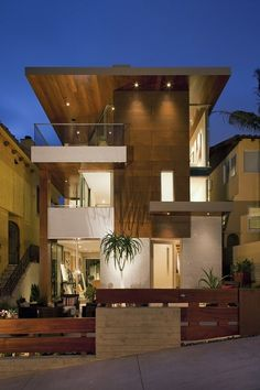 Guglielmo-Gaines Residence, Manhattan Beach, CA. Designed by Michael Lee Architechs. http://mleearchitects.com/project/Guglielmo-Gaines  The front façade consists of a large COR-TEN 'weathering steel' panel that hangs over the limestone entryway.