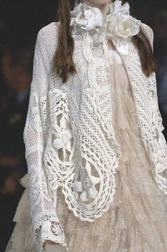 Antonio Marras. It could be done with doily's and an old sweater, some flowers, ribbon.
