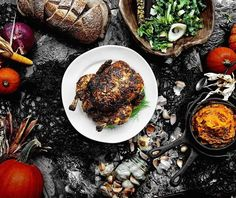 Herb-encrusted heirloom chickens stuffed with a rustic cornbread dressing and slowly smoked over a smoldering inferno of charcoal and hardwoods. Prepared to tender succulent perfection and sided by a glorious cornucopia of farm to table fixins. Cheers. Long live the long weekend. -David  #backyardbbqhero #grill #grilling #grilled #bbq #barbecue #braai #asado #churrasco #carne #chicken #paleo #fall #autumn #instagood #foodstagram #foodgasm #food #weekend #recipe #nomnom #getinmybelly…
