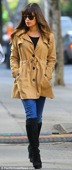 lea michele + jeans.   Flat heeled boot instead of high heeled boot.