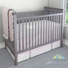 Crib bedding in Pink Osborne Damask, Solid Pink, White Minky Chenille, Natural Minky Chenille, Solid Antique White. Created using the Nursery Designer® by Carousel Designs where you mix and match from hundreds of fabrics to create your own unique baby bedding. #carouseldesigns