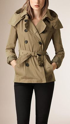 Burberry Sisal Hooded Short Showerproof Trench Coat -  A short lightweight trench coat crafted from technical showerproof fabric.  Cut for a close fit, the double-breasted trench coat features a detachable hood, set-in sleeves and a belted waist.  Discover the women's outerwear collection at Burberry.com