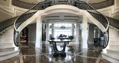 Check out the grand entrance and staircase of a custom home by Luxury Home Solutions that was built in Naples FL. We are the top custom home builders in Southwest Florida. If you are going to build a home you might as well get what you want by customizing rather than getting stuck with the standard cookie cutter home most builders provide.  http://ift.tt/2tCkWnJ #LHS #LuxuryHomeSolutions #HomeBuild #CustomHomes #Naples #FortMyers #BonitaSprings #Alva