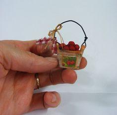 Miniature apples in bucket.