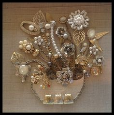 Neutral bouquets are always the best sellers.  Gold and silver mixed jewelry...rhinestones and pearls.  By Brenda Henning