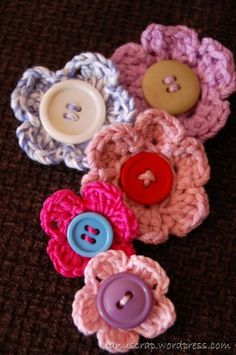 Crotchet and button flowers - These would be cute for little girls headbands