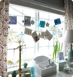 Idea- use twine or ribbon and small clothespins in front of windows