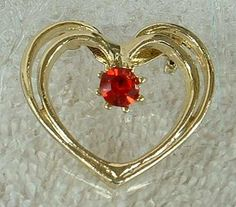 """What a beautiful pin! The heart is doubled up at the top, making the pin very three-dimensional. The red ruby chaton-cut rhinestone sparkles like crazy, and has small beads set around it. The heart measures 1 1/4"""" x 1 1/8"""", and is in excellent condition. A great present for a loved one. It will be shipped in a gift box. #shopifypicks"""