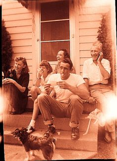I love old family photos - particularly candid shots. 1950s Family Sitting On Steps Suburbia vintage Photo | Flickr - Photo Sharing!