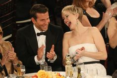 Pin for Later: The Amazing 2014 Award Show Snaps You Probably Forgot About  At the Globes, Jennifer Lawrence cracked up alongside Bradley Cooper.
