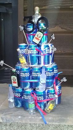 30th bday beer can cake!! Definitely would be miller lolDecked out with mini bottles of booze, 30glasses, a shot glass and some ribbon. Huge hit with my hubby on his special day.