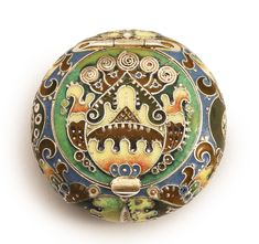 A FABERGÉ GILDED SILVER AND CLOISONNÉ ENAMEL PILL BOX, MOSCOW, 1908-1917 enameled with stylized foliate ornament and with applied ornamental cloisons, struck K. Fabergé in Cyrillic with Imperial warrant overstriking mark of Fedor Rückert, 88 standard, scratched number 217911 and later dedicatory inscription