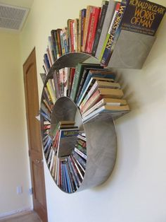 Spiral bookshelf. This is awesome!  Etsy listing at https://www.etsy.com/listing/155846308/spiral-bookshelf-medium