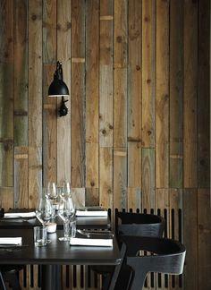 reclaimed wood planks, Tom Dixon slab chairs, Normann Copenhagen flatware