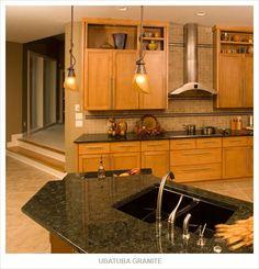 dark granite, honey oak, light back splash. Like the backsplash in similar color as cabinets