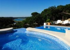 View of the Mira river from the pool. http://www.hideawayportugal.com/modules/property/listing-1082.htm