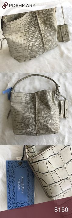 SimplyVera Python Satchel SimplyVera from Kohls bag still with tags.  Python bag (not real) but never been used and in excellent condition.  MAKE AN OFFER!!!  Cheaper through ️️ and shop my other designer items through instagram @erinsonlinewardrobe or ask about PAYMENT PLANS!!! Simply Vera Vera Wang Bags Satchels