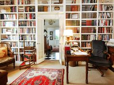 Love the bookshelves completely surrounding the door, especially since they are full of BOOKS rather than accessories