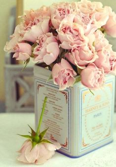 roses in antique tin.. this'd be a great idea for my tin collection