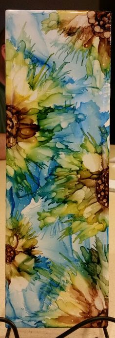Flower in alcohol ink on 12x4 tile. By Tina