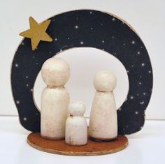 Nativity using little wood pieces and scrapbook paper.  See instructions or buy the finished piece from Abbott's Craft & Variety