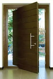 resultado de imagen para puerta pivotante exterior madera