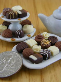 I own quit a few earring pairs featuring tiny food made by this artist. His work is AMAZING! Luxury Praline Collection by Shay Aaron, via Flickr