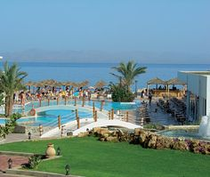 Avra Beach Hotel, Ixia, Rhodes, Greece - one of our recommended budget family friendly holidays. By a small shingle beach, two pools, family rooms and entertainment. Visit the link for more details. #familyholidays #Rhodes #Greece #travel #kids