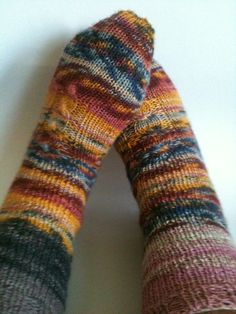 2 at a time, toe up, cable socks with self-striping and self-patterning yarn