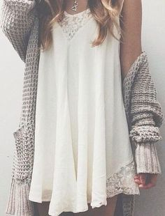transition your summer slip dress into fall with an oversized knit