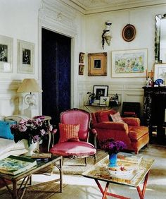 I love the furniture in this room! The french pink chair, the tray tables, and on and on....